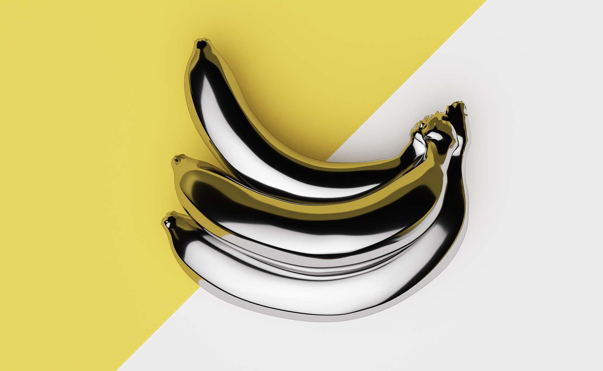 3 bananer betrukket i gul på todelt gul og hvid baggrund