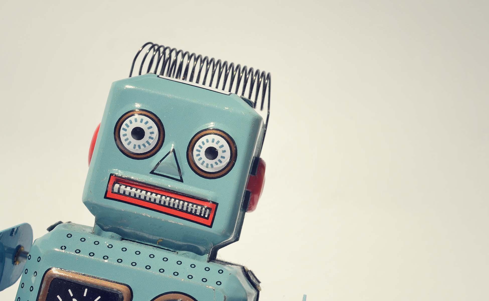 lyseblå tin robot på klar baggrund